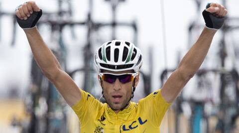 Italy's Vincenzo Nibali crosses the finish line to win the eighteenth stage of the Tour de France. (Source: AP)