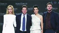 (L-R) Cast members Nicola Peltz, Mark Wahlberg, Li Bingbing and Jack Reynor pose for pictures before the European premiere of the movie Transformers: Age of Extinction in Berlin