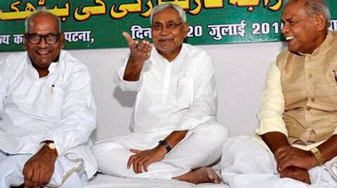 Senior JD(U) leader Nitish Kumar with Bihar Chief Minister Jitan Ram Manjhi and State President Vashist Narayan during a Party State executive meeting in Patna on Sunday. (Source: PTI)