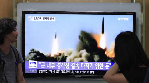 People watch a TV news program showing the missile launch conducted by North Korea, at Seoul Railway Station in Seoul, South Korea. (Source: AP)