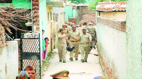 Police do the rounds of Sarfabad village in Noida on Tuesday. (Source: Express photo by Gajendra Yadav)