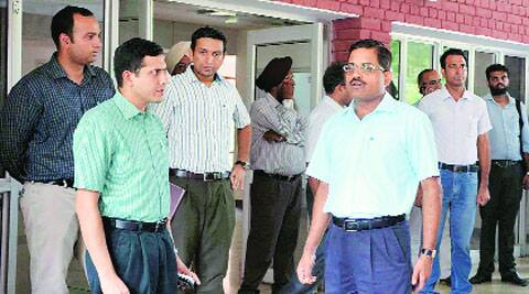 DC Rajat Aggarwal (left) with the officials of the Engineers India Limited in Ludhiana on Monday. Gurmeet Singh