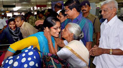 An emotional and warm welcome awaited the nurses at the Kochi airport as they reunited with their families. (Source: PTI photo)