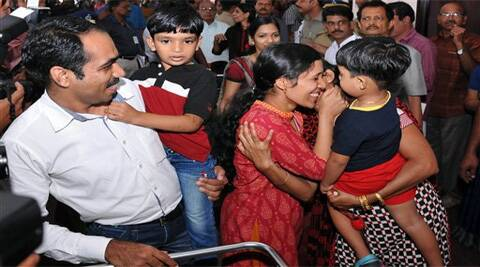 An Indian nurse, center, who was among 46 nurses stranded in territory held by Islamic extremists in Iraq, greets a family member upon arrival at the airport in Kochi (Source: AP)