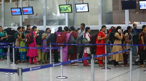 Indian nurses who were trapped in territory captured by Islamic militants wait for the plane to begin their journey home at Irbil International Airport, Iraq, on Friday. (Source: AP)