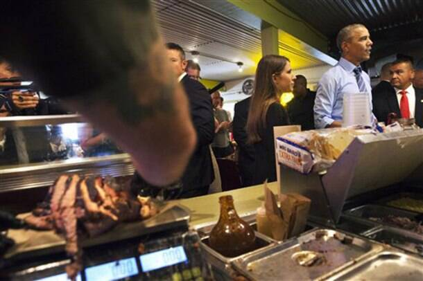 Obama jumps queue at famed Austin barbecue joint, pays for lunch