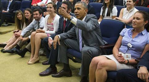 US President Barack Obama calls a foul on the Belgians as he takes a seat to watch during a staff viewing party in Washington. (Source: Reuters)