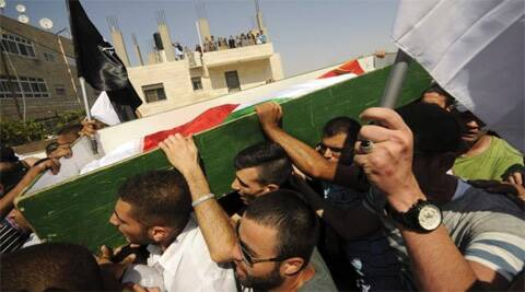 Palestinians carry the body of 16-year-old Mohammed Abu Khdeir in Jerusalem on Friday, July 4, 2014. (Source: AP)