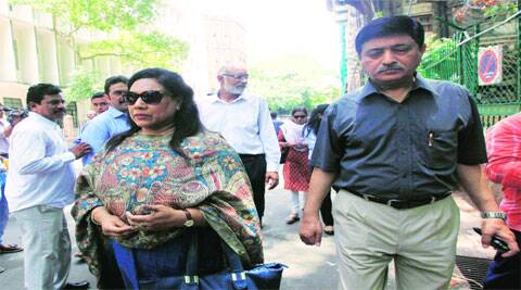 Pallavi's parents outside the court on Monday.