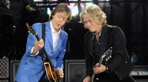 "He paid tribute to former songwriting partner John Lennon with the song 'Here Today'. Sir Paul McCartney, left, performs with band member Brian Ray during the ""Out There"" Tour at the Times Union Center on Saturday (July 5). (Source: AP)"