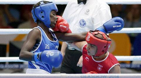 Pinki Jangra (in red) in action in her quarters bout against Nigeria's on Wednesday. (Source: PTI)