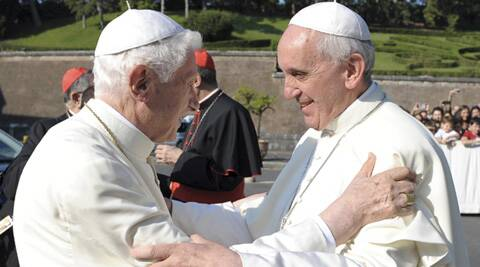 In this July 5 photo provided by the Vatican newspaper L'Osservatore Romano, Pope emeritus Benedict XVI, left, is welcomed by Pope Francis during a ceremony at the Vatican. The Vatican has cast doubt on the possibility that Argentine Pope Francis and his German predecessor would get together to watch their home teams in the WC final. (Source: AP)