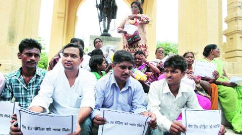 Relatives of Mohanlalganj case victim sit on dharna under the banner of Brahman Maha Sabha at Gandhi Statue, Lucknow, Wednesday. (Source: IE photo by Vishal Srivastav)