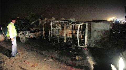 A police Gypsy  torched by protesters in Mukherjee Nagar on Thursday evening; (left) a Haryana Roadways bus was damaged in stone-pelting.  (Source: IE photo by Amit Mehra)