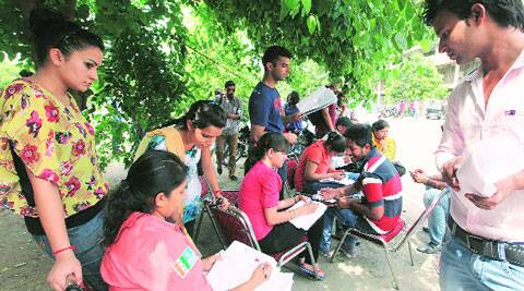 NSUI volunteers help students fill forms at Panjab University on Wednesday. (Source: Express photo by Jasbir Malhi)