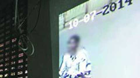 A CCTV grab of two 'suspects' in the case. ( Source: Express photo )