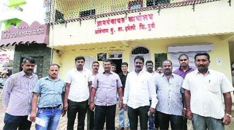 Some Ambegaon Budruk panchayat members along with villagers in front of panchayat office on Monday.  (Pavan Khengre)
