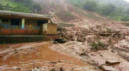 Nearly 170 people are feared trapped with several houses coming under the landslide triggered by heavy rains in Ambegaon in Pune. (Source: Express Photo)