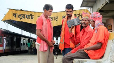 Porters listening to the Railway Budget speech at Balurghat station in South Dinajpur district of West Bengal on Tuesday. (PTI)
