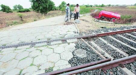The unmanned crossing where the accident took place in Kherwa village of Vadodara on Tuesday. (Express Photo:  Bhupendra Rana)