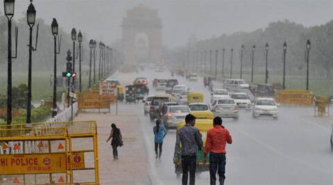People move at the Rajpath amid heavy shower in New Delhi. (Source: PTI)