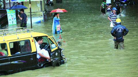 Waterlogging at Hindmata in Parel on Wednesday. (Source: Express photo by Ganesh Shirsekar)