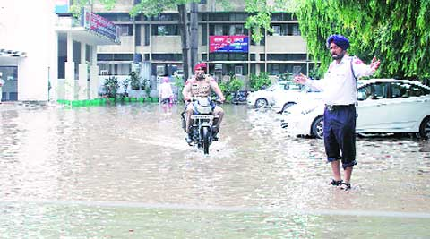 Industrialists stated that it was for the third time that the sub-station had been flooded and every time industrialists had to remain without power till the situation normalised. (Source: Express photo by Gurmeet Singh)