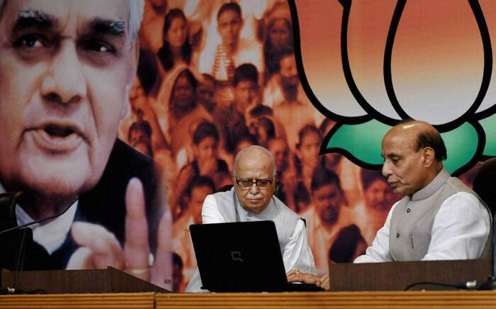 BJP President and Union Home Minister Rajnath Singh with senior leader L K Advani launch online membership of BJP on the occasion of Shyama Prasad Mookerjee birth anniversary at the party office in New Delhi. (Source: PTI)