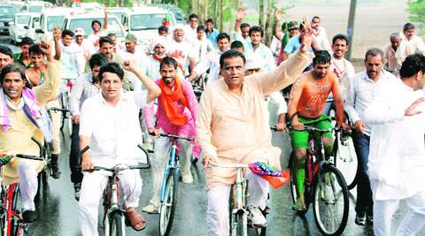 O P  Dhankar leads a bicycle march in Jhajjar on Sunday.