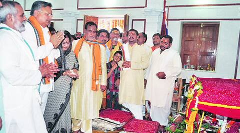 CM Raman Singh with his wife and Speaker Gauri Shankar Agarwal at the inaugural pooja at the temple complex in April 2012. Source:Express