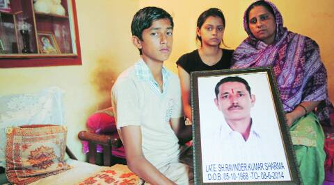 Family members of Ravinder Kumar Sharma at their house in Chandigarh on Tuesday.
