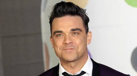 Robbie Williams is currently on the UK leg of his 'Swings Both Ways' tour. (Source: AP)