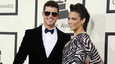 Singer Robin Thicke and his estranged wife Paula Patton have put their Los Angeles mansion on the market.