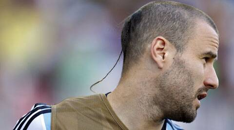 Argentina's Rodrigo Palacio's rat tail is unlikely to be the most flattering style in Brazil. (Source: AP)