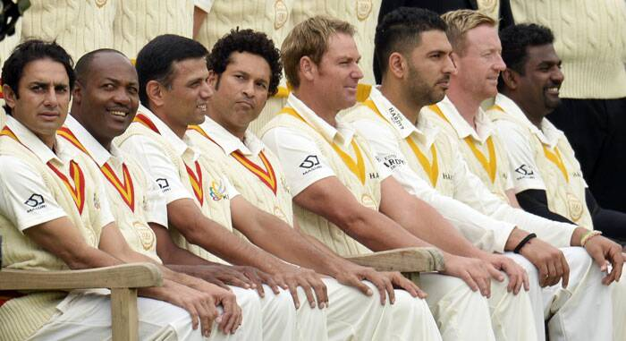 Sachin Tendulkar and Shane Warne, captains of  MCC and ROW respectively, pose for a group photograph ahead of the starry contest at Lord's (Source: Reuters)