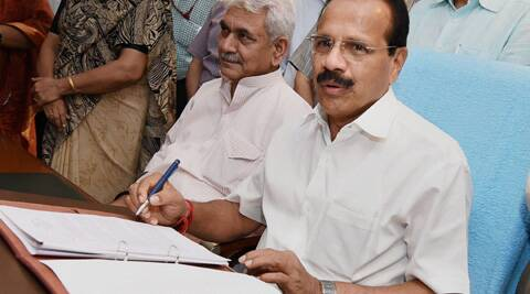 Union Railways Minister D.V.Sadananda Gowda giving final touches to the rail budget 2014-15 on the eve of its presentation in Parliament, at Rail Bhavan. (PTI)