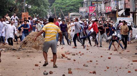 Stone pelters in action during violent clashes between two communities over a land dispute in Saharanpur on Saturda