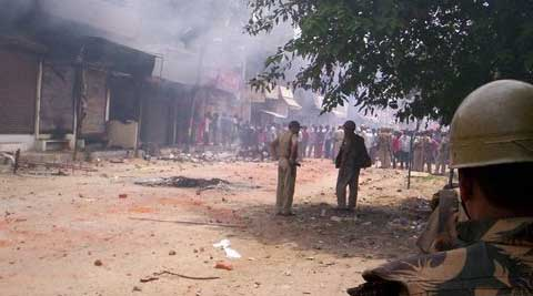 Three persons were on Saturday killed and 19 others, including policemen, injured in the clashes as mobs indulged in arson after which curfew was clamped and shoot-at-sight ordered. (Source: PTI)
