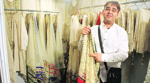 Pakistani designer Willy with his creations. (Source: Exprtess photo by Gurmeet Singh)