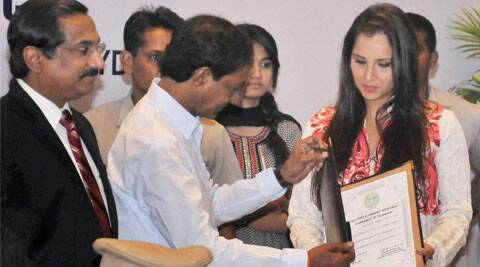 Telangana chief minister K.Chandrashekhar Rao presenting a letter of appointment as Telangana's Brand Ambassador to Sania Mirza in Hyderabad. (Source: PTI)