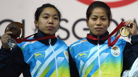 Gold medalist Sanjita Khumukcham and compatriot silver medalist Chanu Saikhom during the medal presentation ceremony. (Source: AP photo)