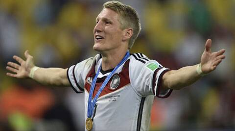 Germany's Bastian Schweinsteiger celebrates after winning the World Cup final against Argentina. (Source: AP)