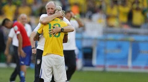 Luiz Felipe Scolari pacifies an emotional Neymar during their match against Chile. Brazil won the match on penalties. (Source: AP)