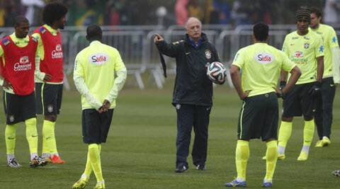 Brazil's coach Luiz Felipe Scolari talks with his players during a training session in Teresopolis near Rio de Janeiro on Friday. (Source: Reuters)