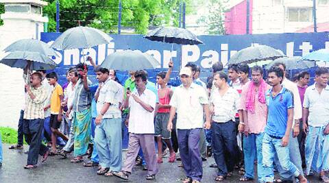 Workers and locals in front of closed Shalimar Paints in Howrah Wednesday