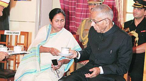 Chief Minister Mamata Banerjee with Governor  M K Narayanan after the swearing-in of new ministers at Raj Bhavan on Wednesday. Narayanan will demit office on July 4. ( Express photo by: Subham Dutta )
