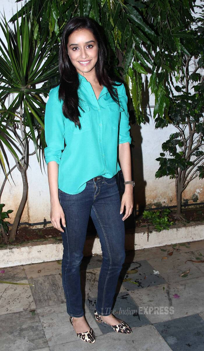 Shraddha was chic in demins and green shirt, She let her hair fall straight and finished her look with minimal make-up and leopard print shoes. (Source: Varinder Chawla)