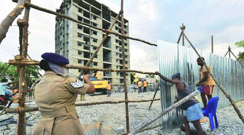 Tamil Nadu govt staff seal the site of the collapse in Chennai on Friday. ( Source: PTI )