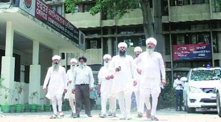 Members of a group of Namdharis come out after giving a memorandum to the Deputy Commissioner of Police in Ludhiana on Monday.  (Express Photo: Gurmeet Singh)