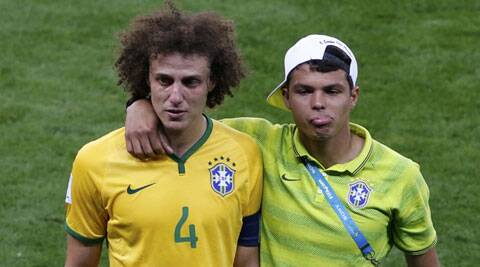 Brazil captain Thiago Silva (R) lament their 1-7 loss against Germany. (Source: Reuters)